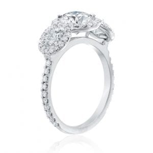 Engagament ring open ring angled view with three round diamonds each with thin diamond halo on white background