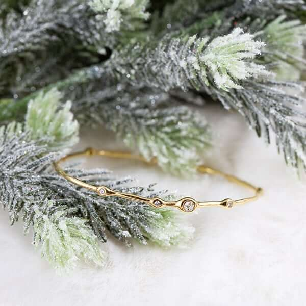 Thin gold bangle with diamonds