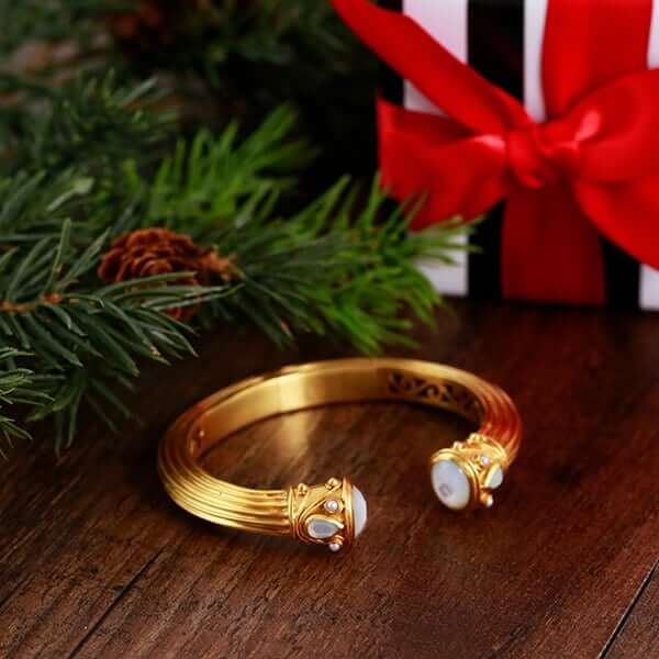 Gold bangle with pearls
