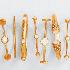 gold and white stone bangles