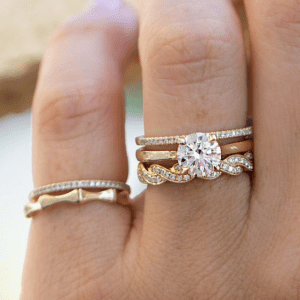 gold and diamond rings on hand