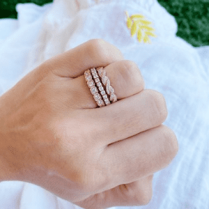 rose gold and diamond rings on hand