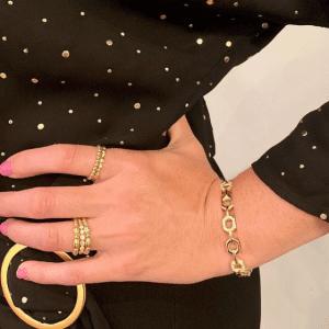 gold rings and bracelet on model