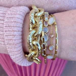 gold and stone bracelets on model