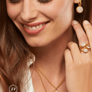 gold necklaces, rings and earrings on model