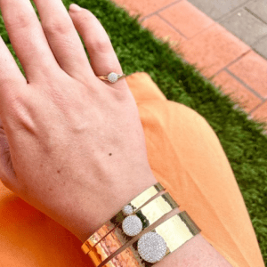 gold and diamond bracelets and ring on model