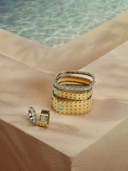Roberto Coin Pois Moi collection bracelets stacked poolside on ledge