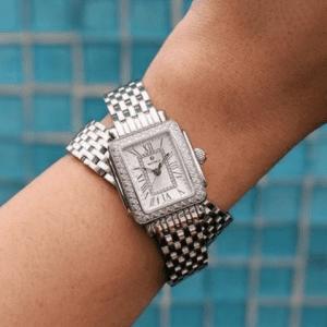 silver watch on wrist