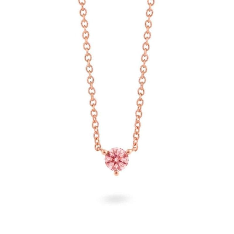 pink round diamond pendant set in 3-prong martini setting stationed on rose gold chain