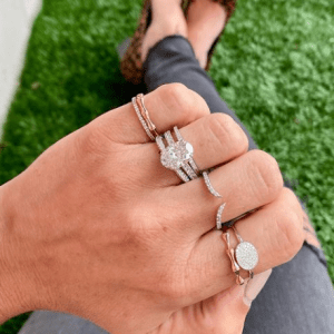 gold, silver and diamond rings on hand