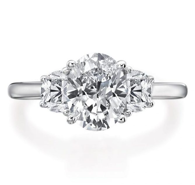 oval with halfmoon three stone engagement ring front view