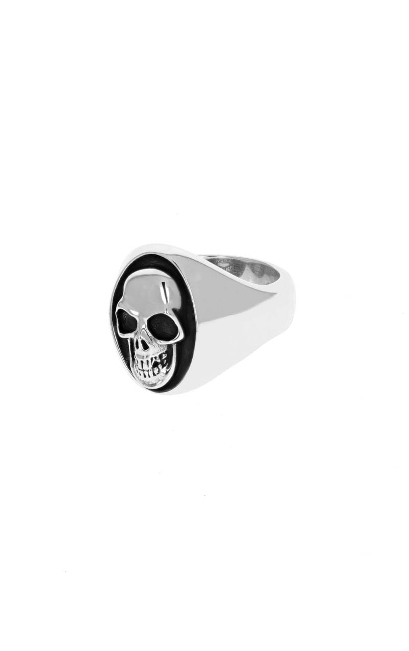 side angle view of silver skull signet ring