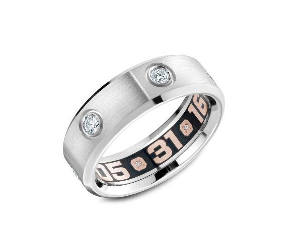 Luxury men's wedding band with diamonds on the exterior and date on the interior