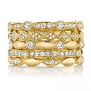 stack of diamond rings in 14kt yellow gold