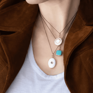 Monica Rich Kosann White Enamel Oval Locket with Green Sapphire
