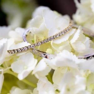 two diamond bracelets on white flowers