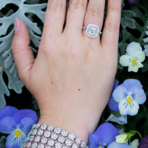 diamond bracelet and ring on model with purple floral background