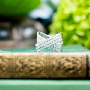 pave diamond ring on green and gold book
