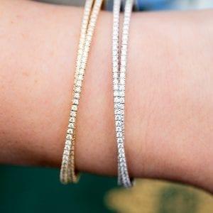 closeup view of pave diamond flexable crossover cuff bracelets on woman's wrist