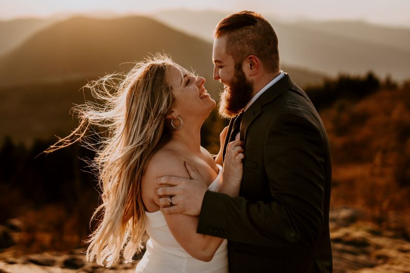 Man and woman hugging on their wedding day in the mountains