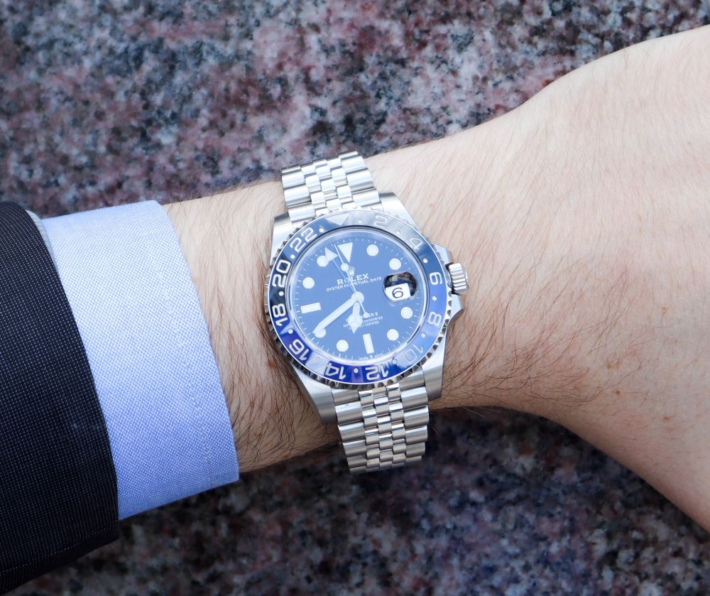Rolex GMT Master II Batman on Man's hand with blue suit